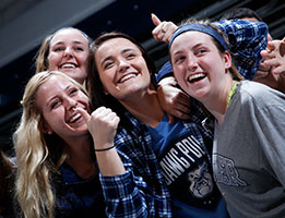 Photo of smiling students at a basketball game. Links to Gifts of Real Estate