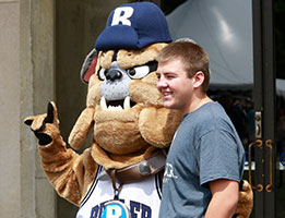 Photo of a student with the Butler mascot. Links to Gifts of Cash, Checks, and Credit Cards