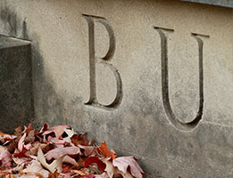 Photo of BU carved in stone. Links to Tangible Personal Property